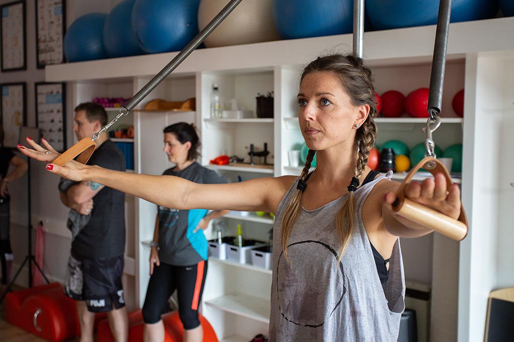 A Pilates Pod Customer using the Pedi Pole