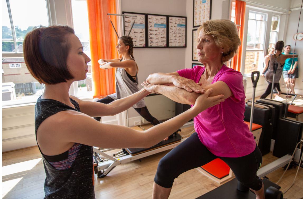 Ellen teaching Pilates on the reformer